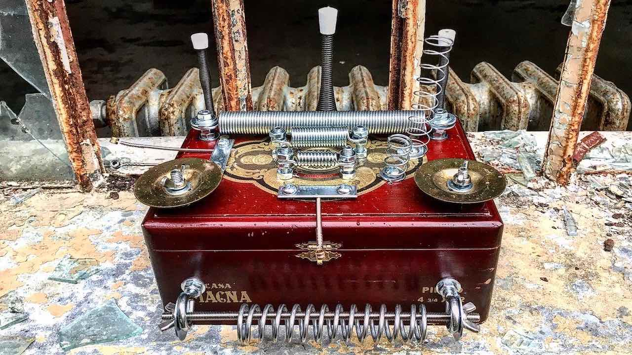 Piezo equipped thrift store cigar box with springs